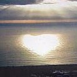 Sun's reflection on the water in the shape of a heart.