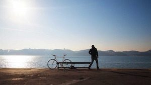 Man and Bike on Beach