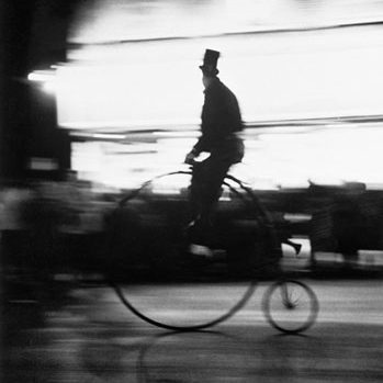 man-on-old-fashioned-bicycle