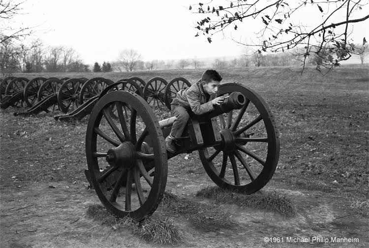 boy on top of cannon