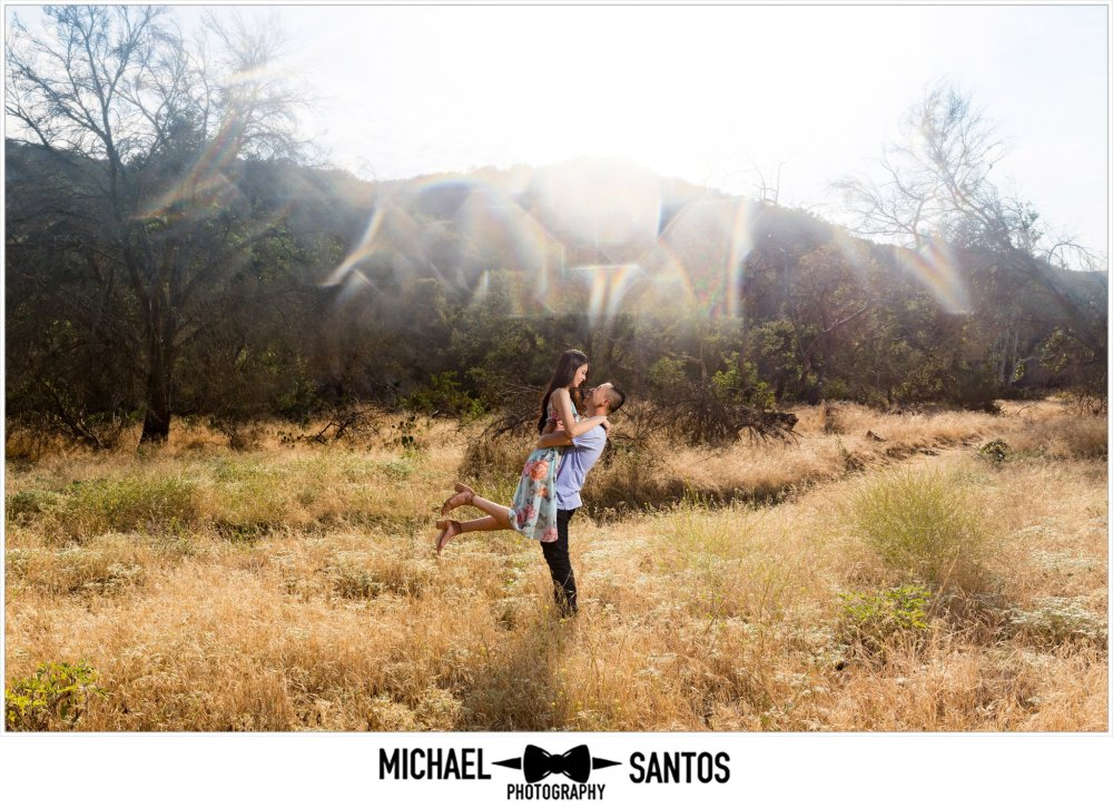 couple in a meadow at their caspers wilderness park engagement photography session