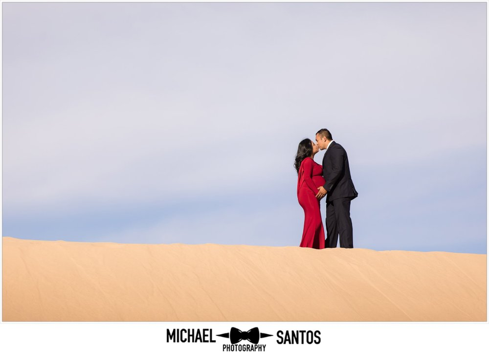 kissing couple on top of glamis sand dune