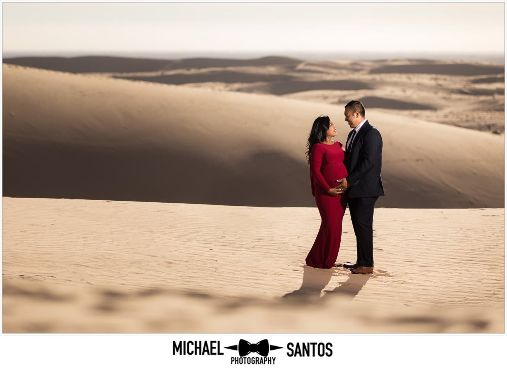epic shot of pregnant couple during their sand dune maternity session