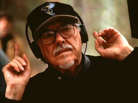 Robert Altman, film deirector seen listening to the soundtrack of a film he is editing