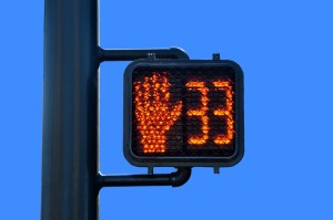 Intersection countdown timer with red hand described in California crosswalk laws.