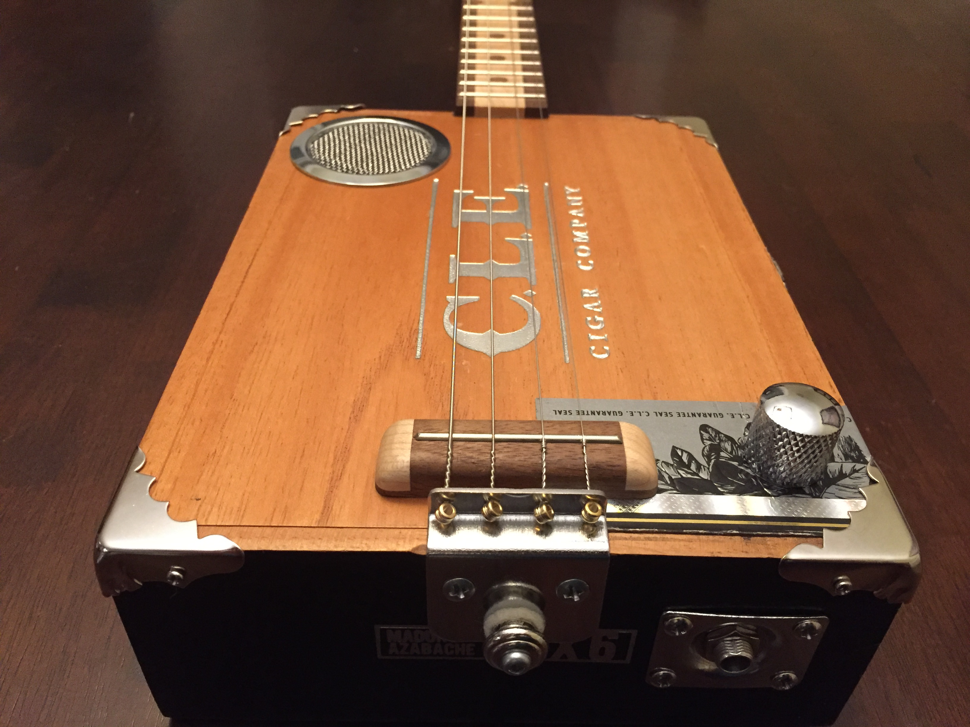 CLE Cigar Box Guitar Build - Corner details, custom bridge and sound hole cover