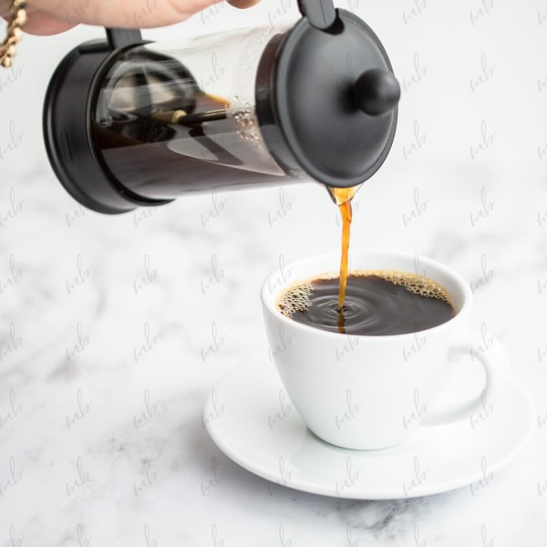 Styled Stock Photo - Coffee being poured