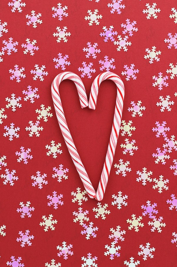 Christmas Styled Stock Photo candy canes on red background