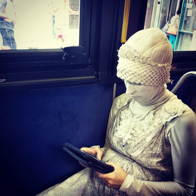 Just a typical summer Sunday in #newyork #mta #womaninwhite #kindle