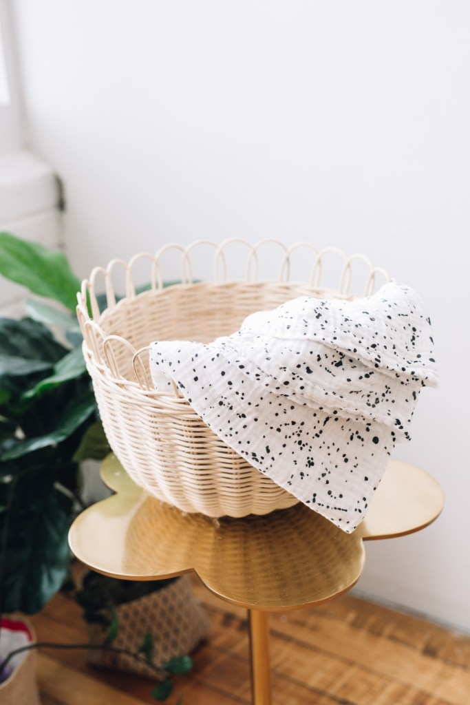 white with black splatter swaddle