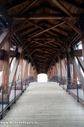 From the Visitor's Center, you'll walk across a covered bridge to the village.