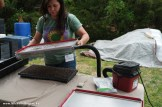 Jillian Mickens demonstrates a vacuum seeder at Open Door Farm.