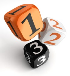 one, two and three numbers on orange black dice blocks