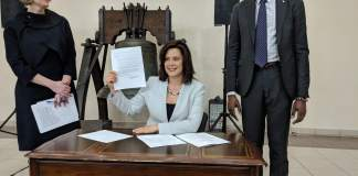 Gov. Whitmer signing an environmental measure