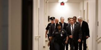 Robert Mueller surrounded by security