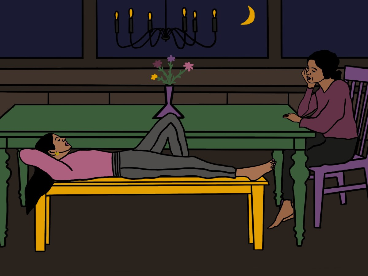 girl laying on dining room table bench, her mom sitting at the table