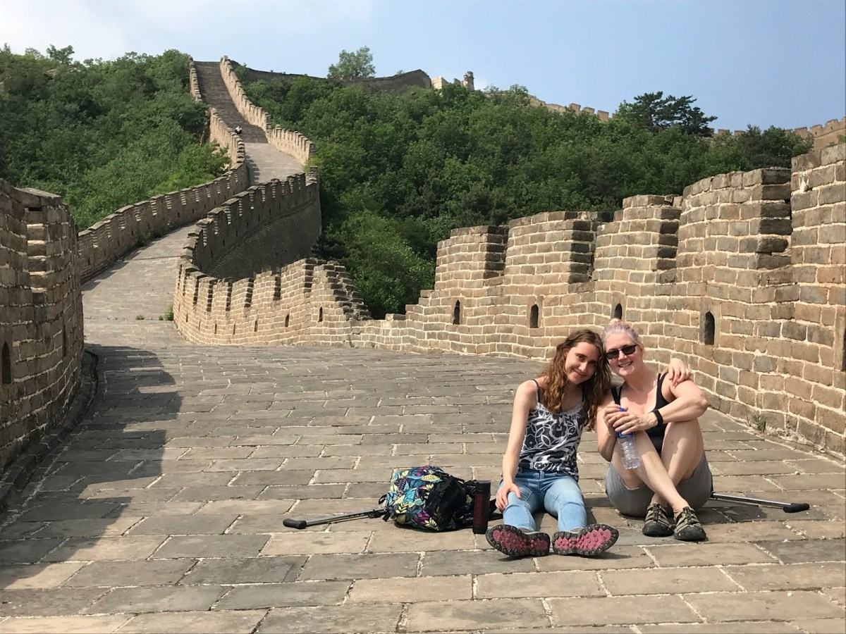 a photo of a girl and her mother at the Great Wall of China