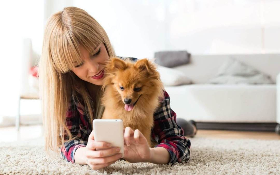 Woman and her dog using telemedicine.