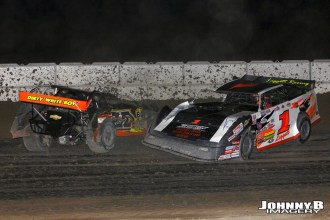 Chad White in the wall and Greg Gokey had nowhere to go Friday night at Winston Speedway. John Berglund Photo)