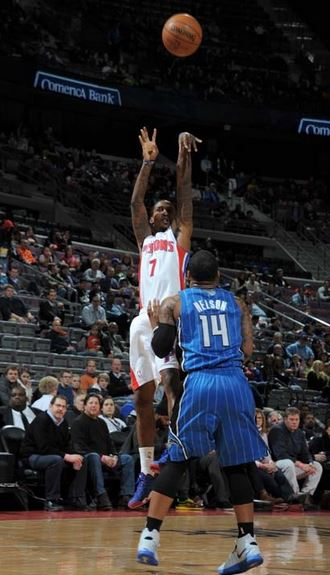 Brandon Jennings shoots over Orlando's Jameer Nelson in the second quarter of Tuesday's game at the Palace of Auburn Hills. The Pistons defeated the Magic, 103-86. (Photo courtesy of Allen Einstein/Detroit Pistons)