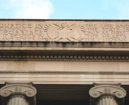 Department of Justice building with Plato Inscription: Justice in the life and conduct of the state is possible only as first it resides in the hearts and souls of the citizens