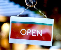 "Storefront ""open"" sign. A DOJ Statement of Interest letter states online grocery stores are public accommodations subject to Title III."
