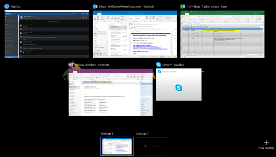 Screen shot showing various programs, along with two Desktop views. Here, the user could navigate from HipChat, Outlook Excel, OneNote and Skype on Desktop 1. The user could also navigate to Desktop 2.
