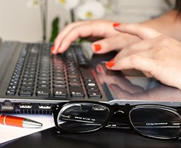Woman's fingers on Windows laptop keyboard