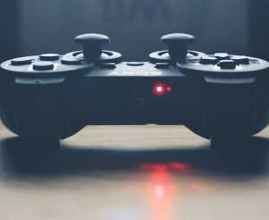 close up of game controller on desk