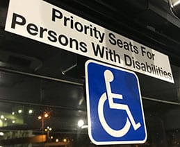 Airport Shuttle Sign: Priority Seats for Persons with Disabilities (c) Microassist