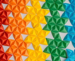 Multi-colored origami stars arranged in a pattern.