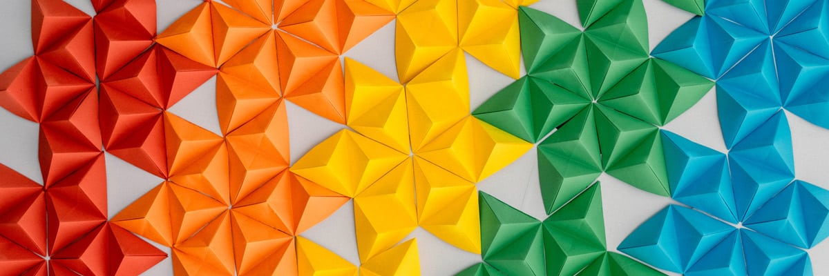 Multi-colored origami triangles arranged in patterns by color