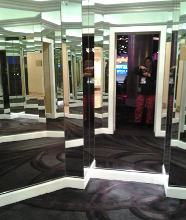 the octagonal mirrored entry to the ladies room