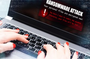 """computer screen displaying the phrase """"ransomware attack"""""""