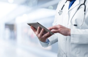 A provider scrolling on a tablet looking at emr training tips