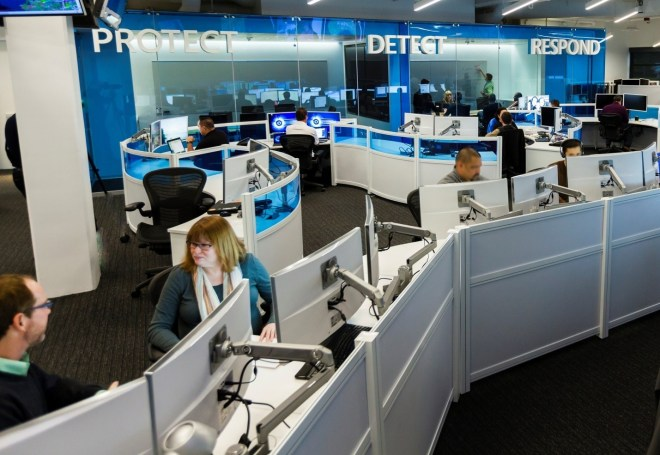 Image of security workers in an office.