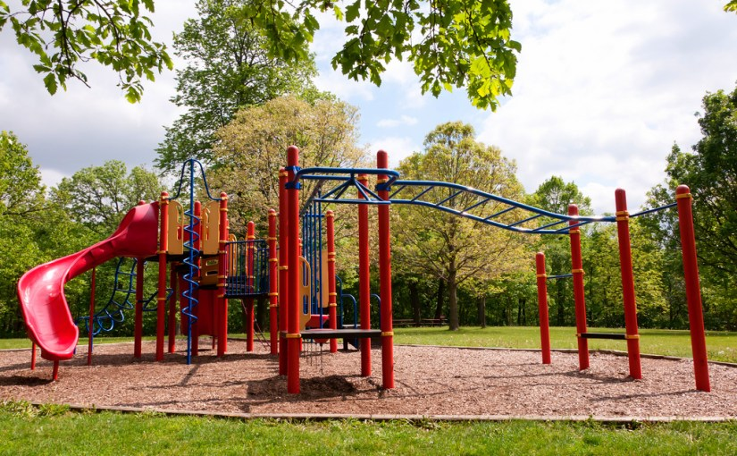 playground featuring slide, monkey bars