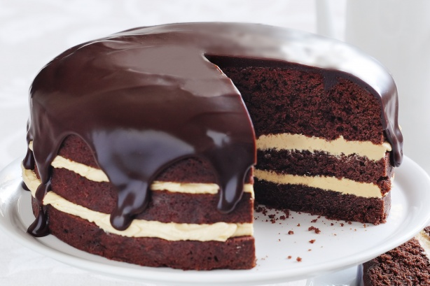 Three layer chocolate cake with vanilla frosting in the middle, chocolate frosting on the outside