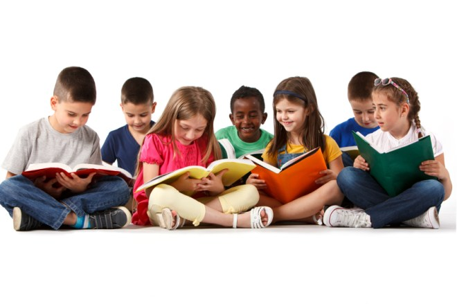 Group of happy multiracial school children reading books. Isolated on white background.