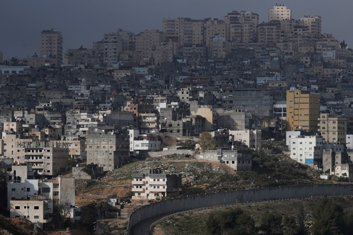 The Shuafat refugee camp in East Jerusalem is seen behind the Israeli barrier, in an area Israel annexed to Jerusalem after capturing it in the 1967 Middle East war January 29, 2020