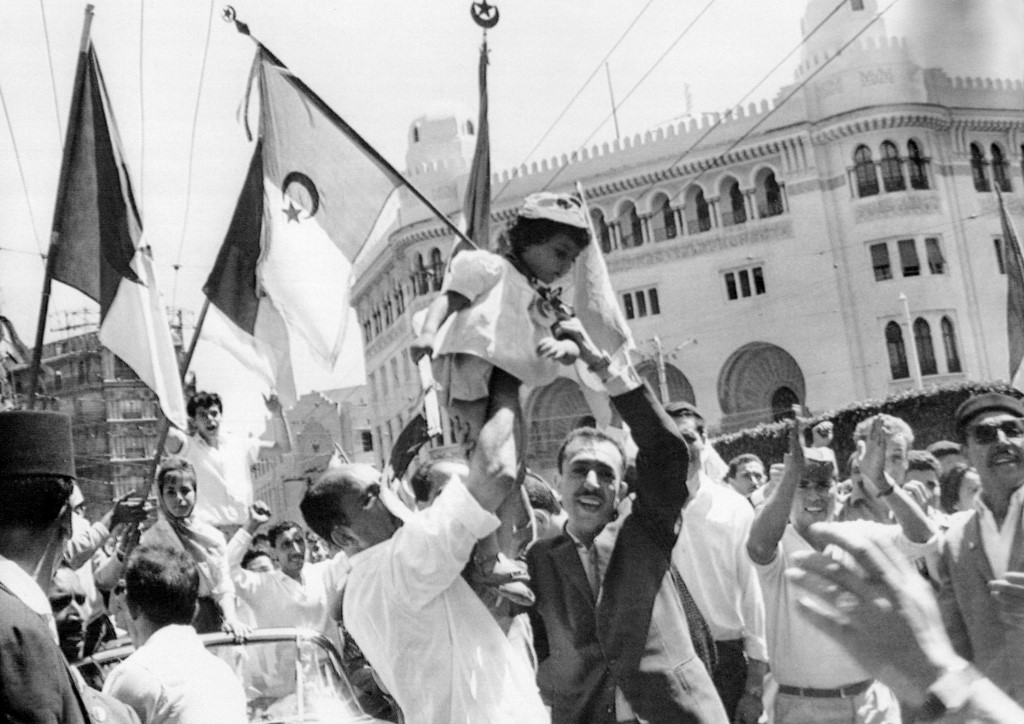 A crowd of Algerians celebrate independence in Algiers in 1962 (AFP)