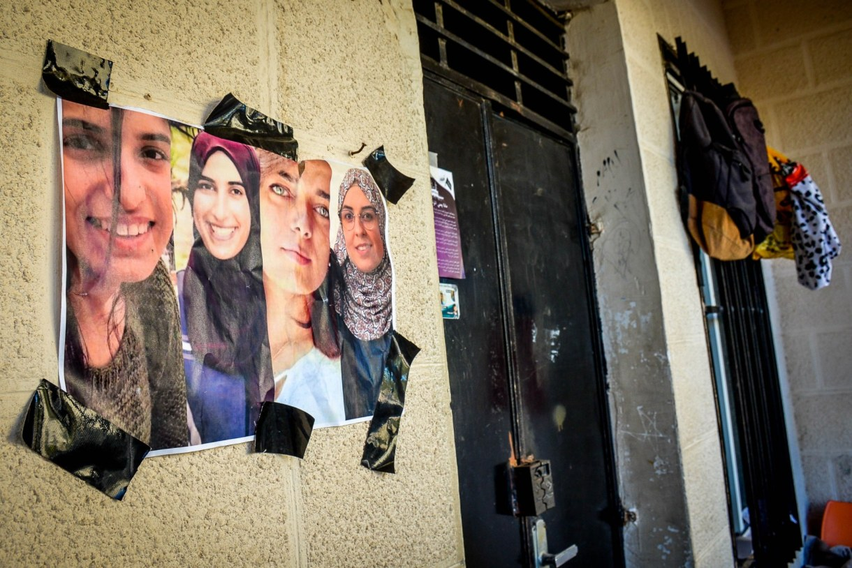 Photographs of detained students are displayed on the Birzeit University campus (MEE/Qassam Muaddi)