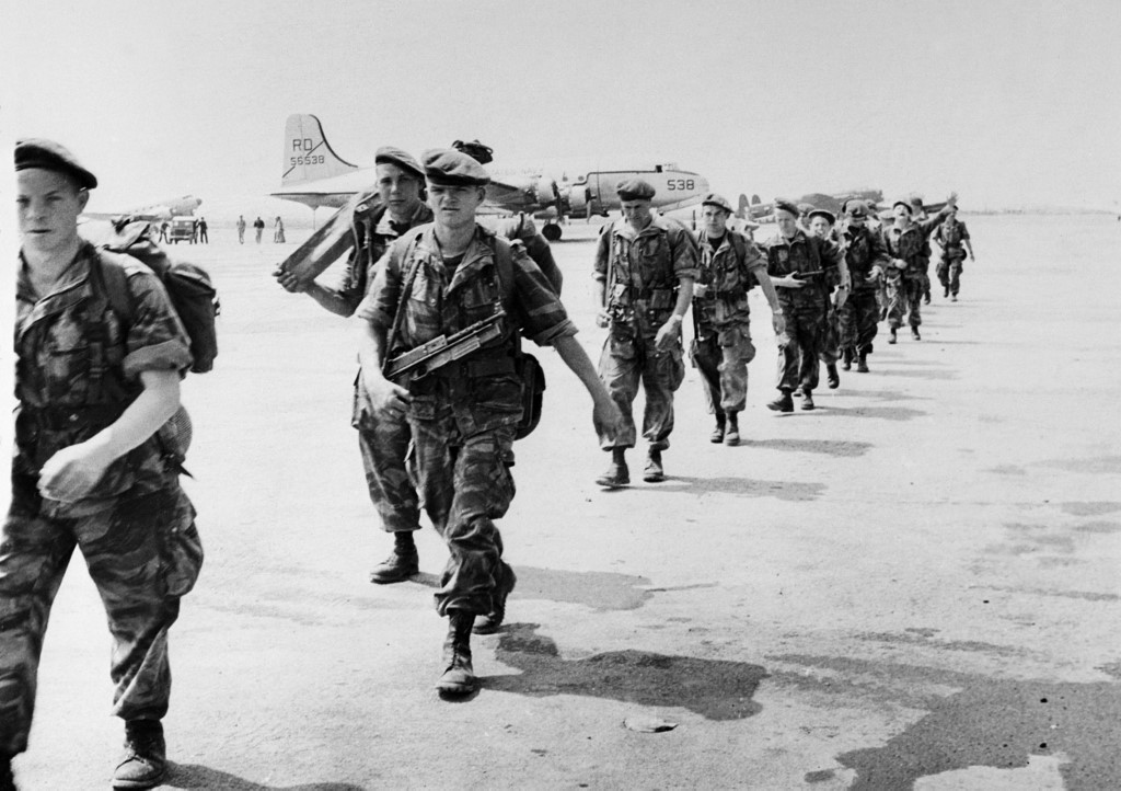 French paratroopers board a transport plane near Algiers in 1956 (AFP)