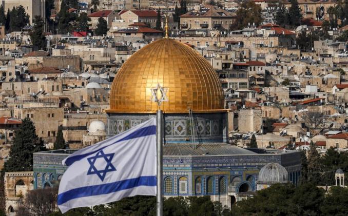 An Israeli flag flies in Jerusalem on 27 January 2020 (AFP/File photo)