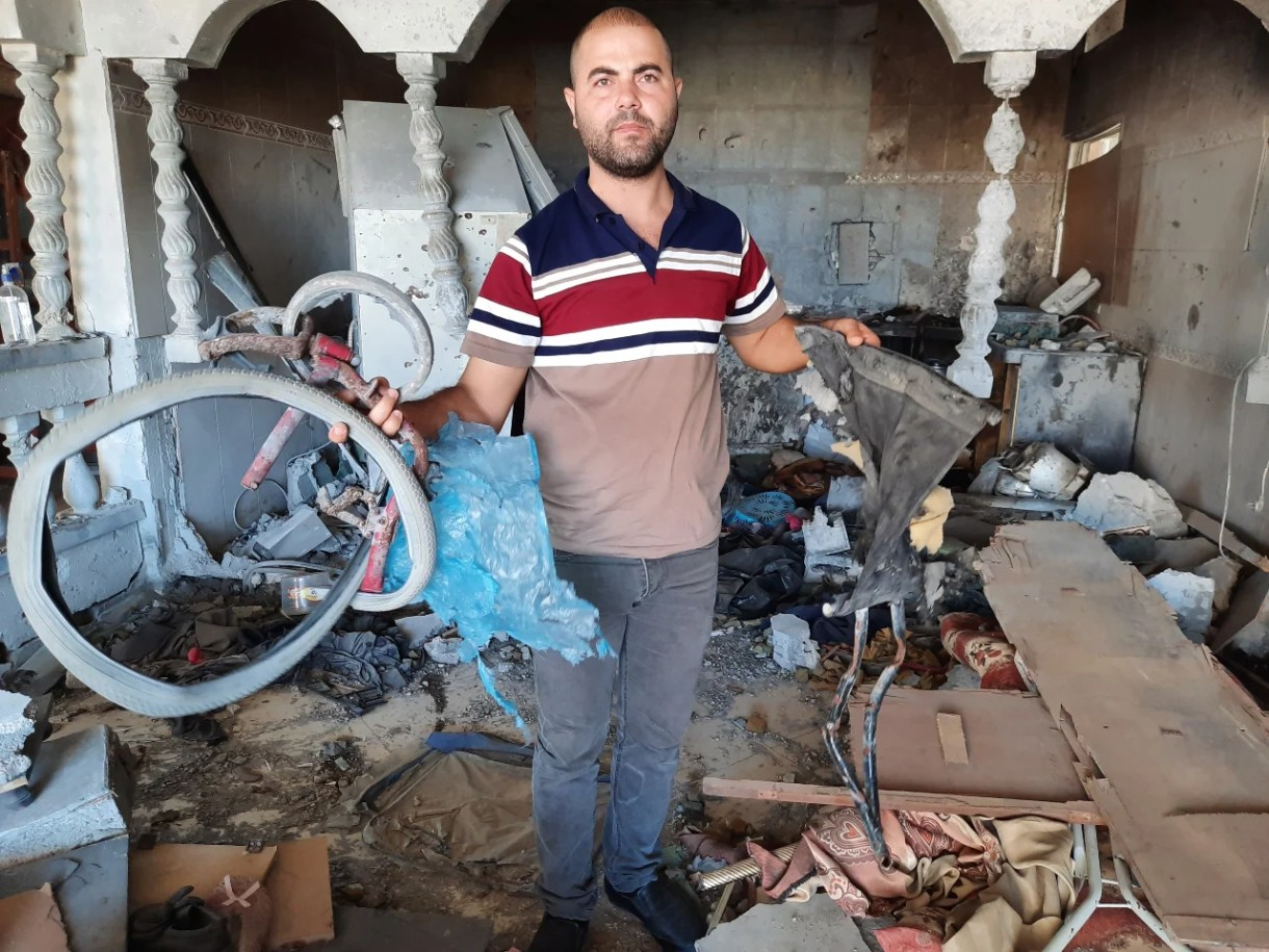 Describing the killing of his brother Iyad Salha, Omar said 'this attack was a dirty operation against a civilian disabled man sitting on his wheelchair' (MEE/Ahmed Al Sammak)
