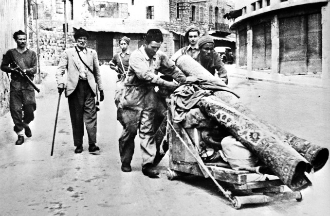 Members of the Haganah paramilitary escort Palestinians expelled from Haifa after Jewish forces took control in April 1948 (AFP/File photo)