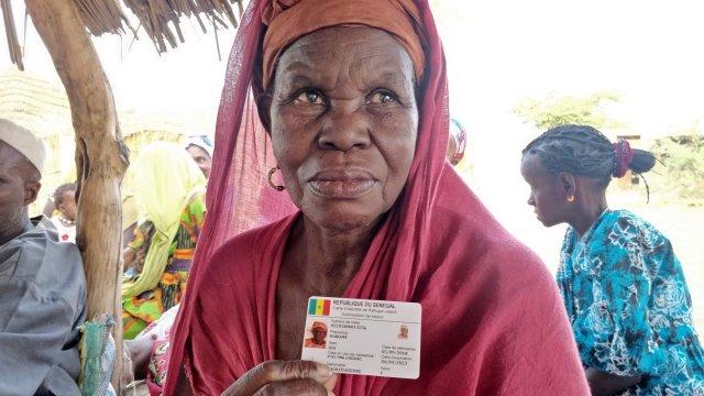 Mauritanian refugee Mariame Dia holds her identity card (MEE/Amandla Thomas-Johnson)