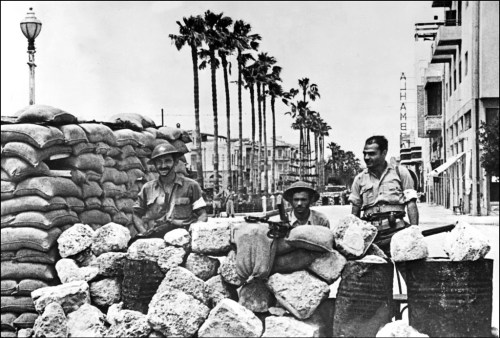 Jewish forces stand guard behind a barricade in Jaffa during fighting with Arab forces in 1948 (AFP)