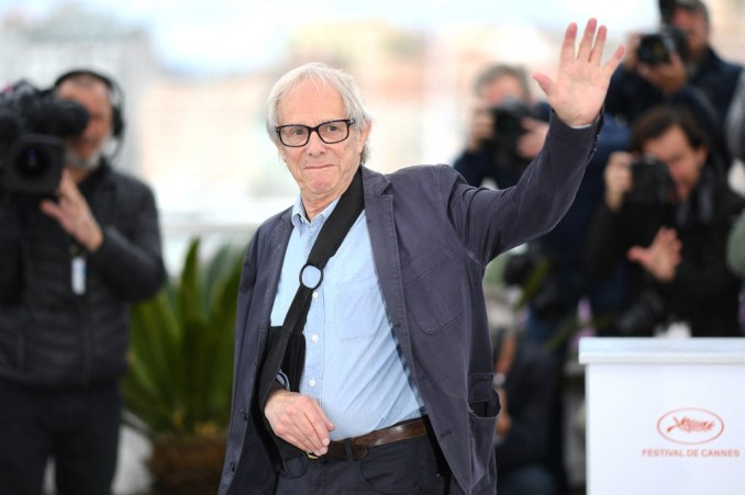 Film director Ken Loach waves during the Cannes Film Festival in 2019 (AFP)