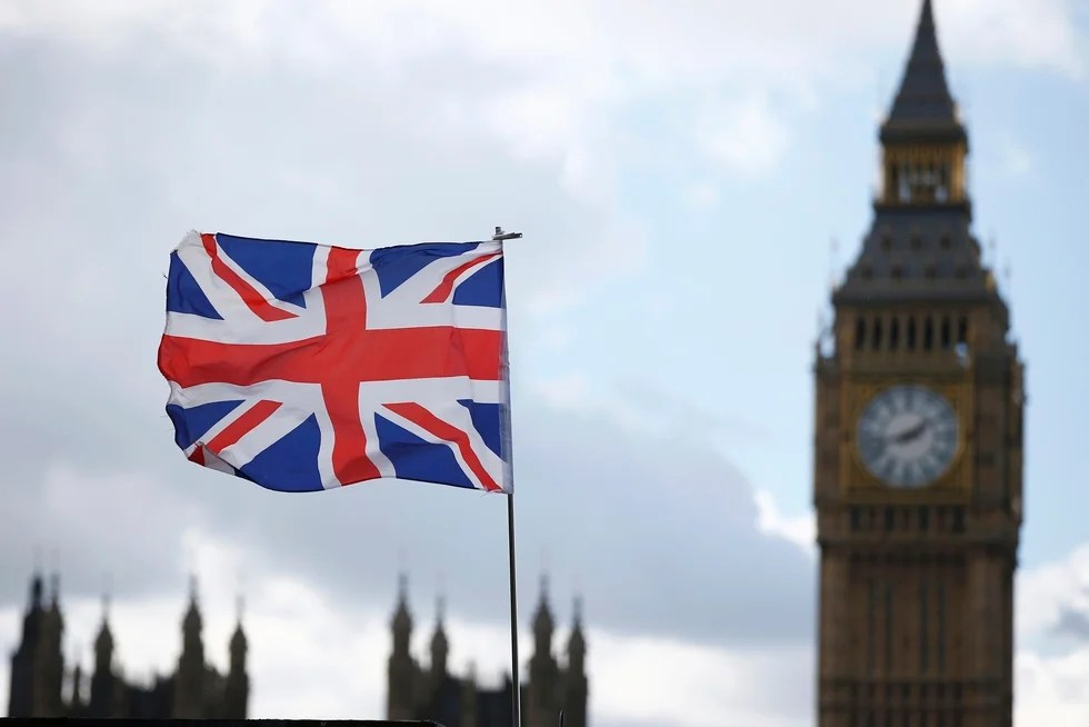 A souvenir flag flies in the breeze opposite the Houses of Parliament in London (Reuters)